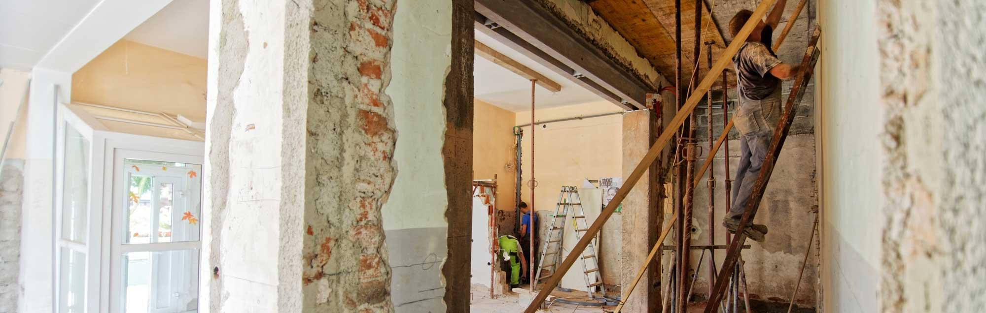 People repairing house damage